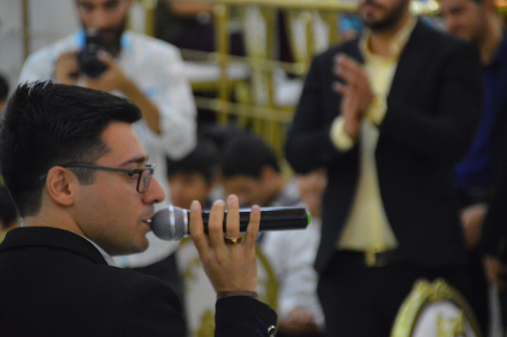 MAHMOOD-ABDOLMALEKI-with-microphone-at-hand